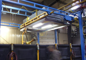 Industrial Maid Robotic and Automated Welding Hood installed in a Nebraska Manufacturing Company to solve welding air filtration challenges
