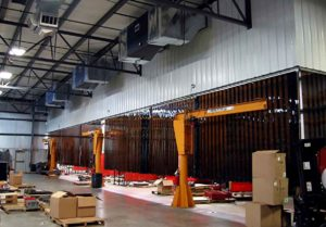 Welding bay or machine area with T4500x2 T-Series Ambient Air Cleaners installed as Industrial Air Cleaner Units