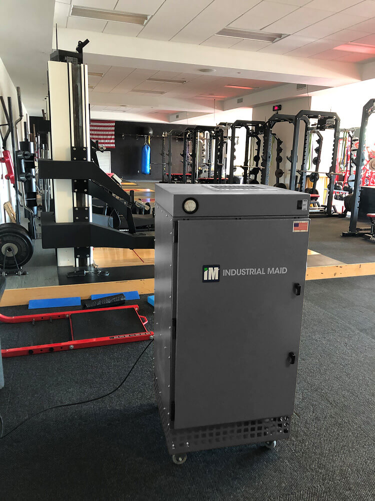 An AZTech 1500iP Industrial Air Purifier in the weight room of the Bob Devaney Sports Center
